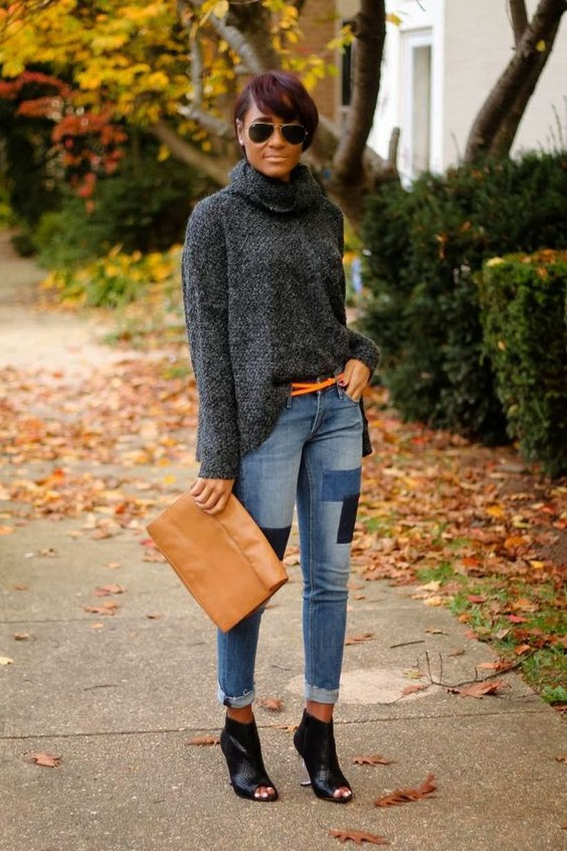 An adorable patchwork blue denim pants with long gray shelves sweaters and black high heels