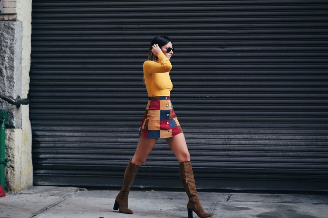 Cute short patchwork skirt with yellow sweaters and combine brown high heels