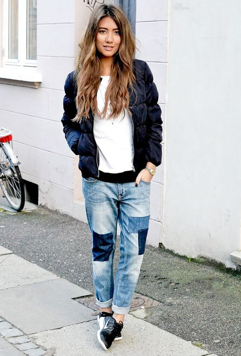 An awesome patchwork denim pants with white t-shirt, black jacket, and black shoes for casual style