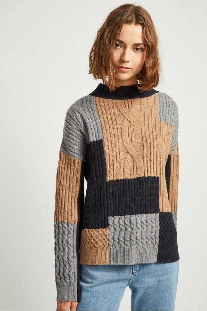 Knit sweater combined with jeans
