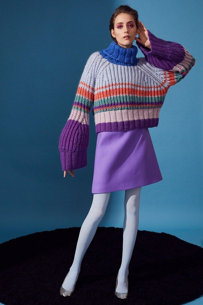 Cute knit sweater combined with purple short skirt