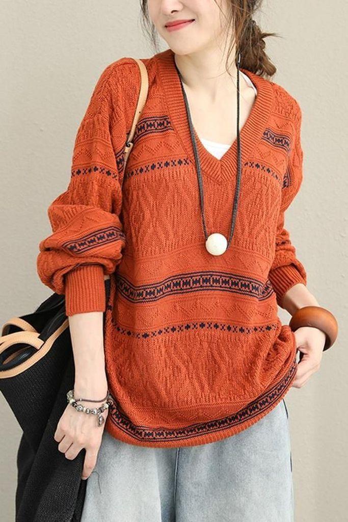 Orange knit sweater with black striped