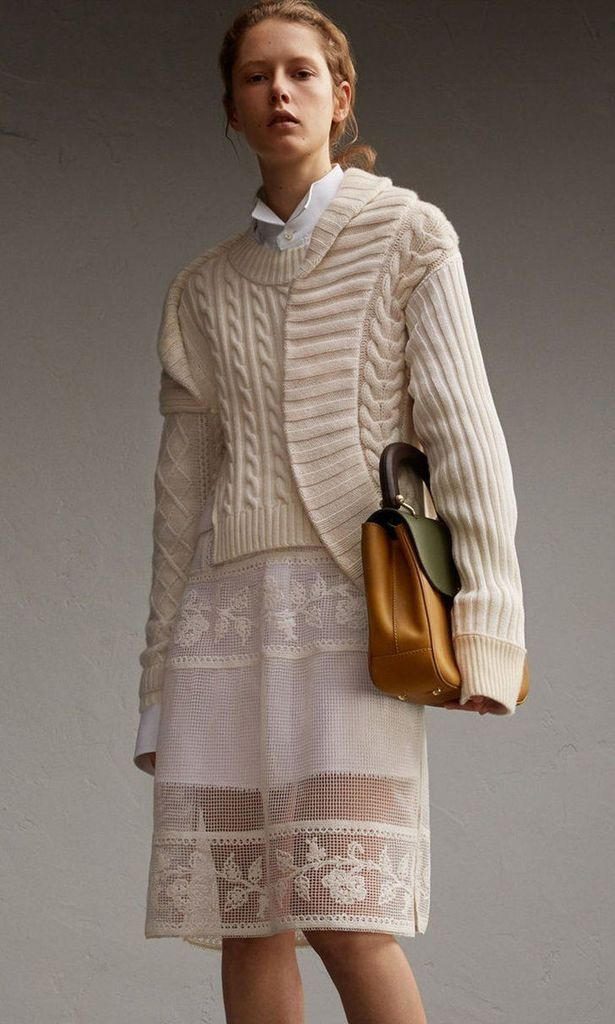 White dress combined with grey knit sweater
