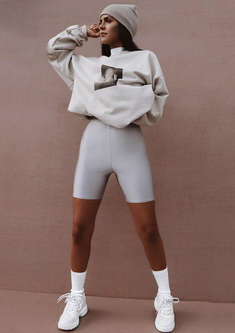 An-elegant-wear-bike-outfit-combined-with-a-white-hoodie-white-bike-shorts-a-pair-of-white-athletic-shoes-and-white-skullcat.-