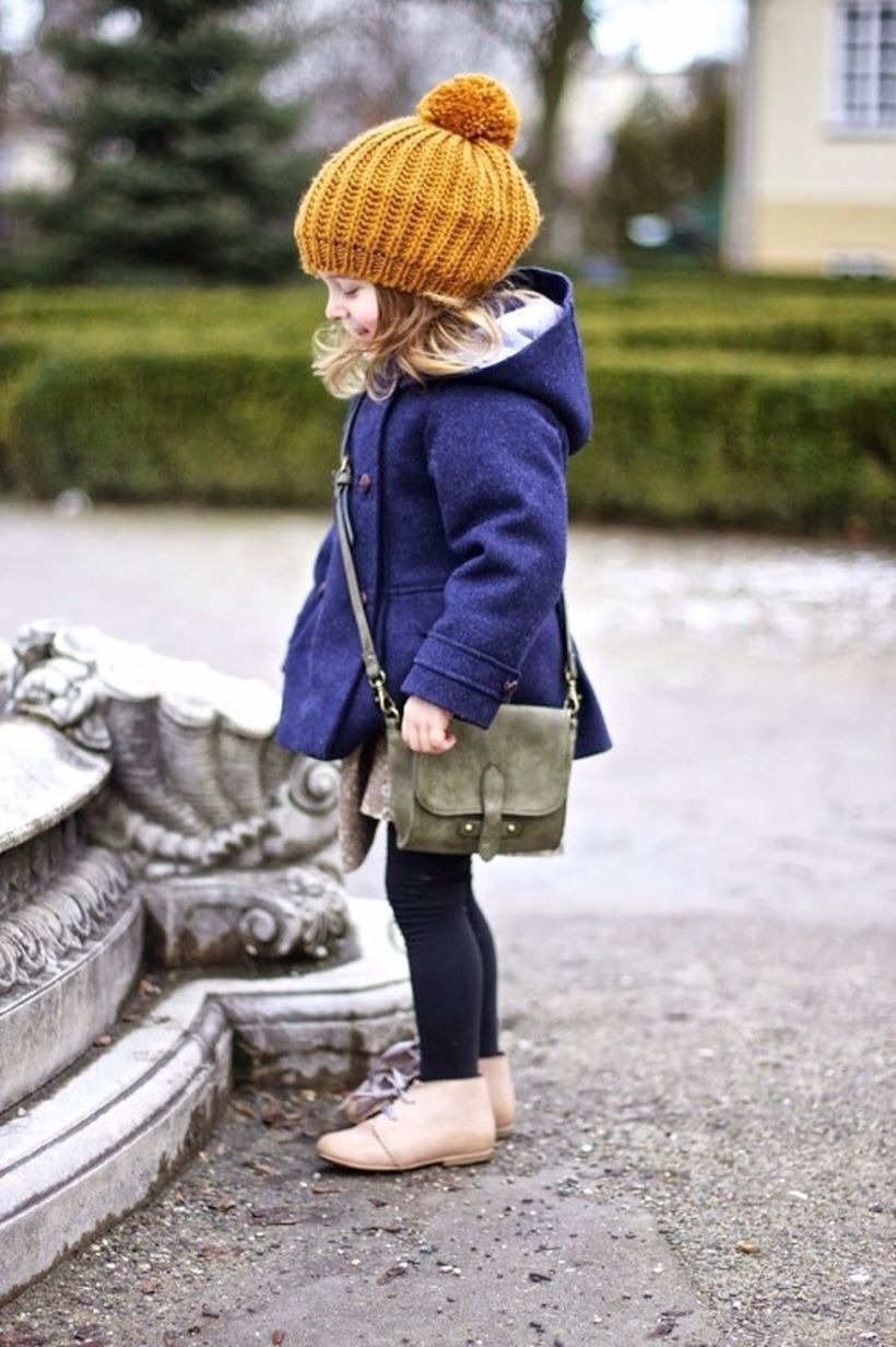 Pretty girl outfit with blue jackets, yellow skullcap, black jeans, brown shoes and a small green bag