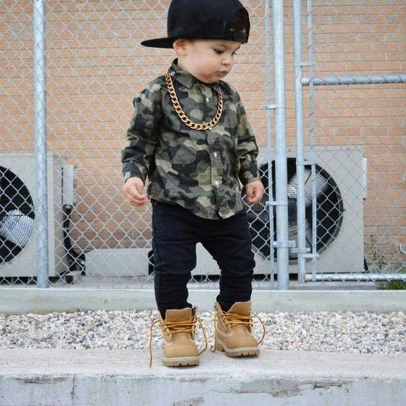 Long-sleeve-shirt-with-camouflage-pattern-and-black-jeans-leather-shoes-and-add-accessories-such-as-hats-and-necklaces