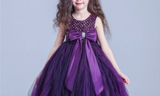Interesting girl outfit with purple dress, purple ribbon butterflies shape and purple flower hair pins