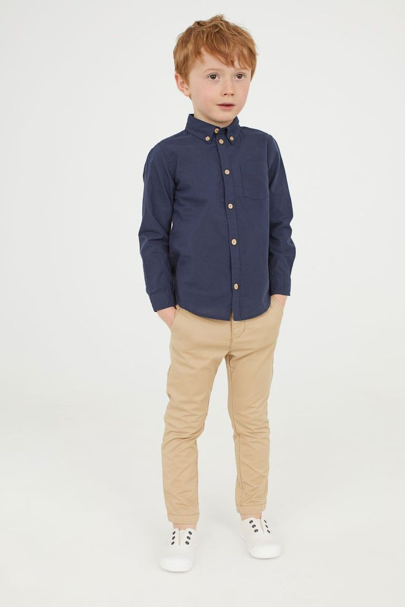 Best decent clothes for boys first day school with blue shirt, beige denim pants and white shoes