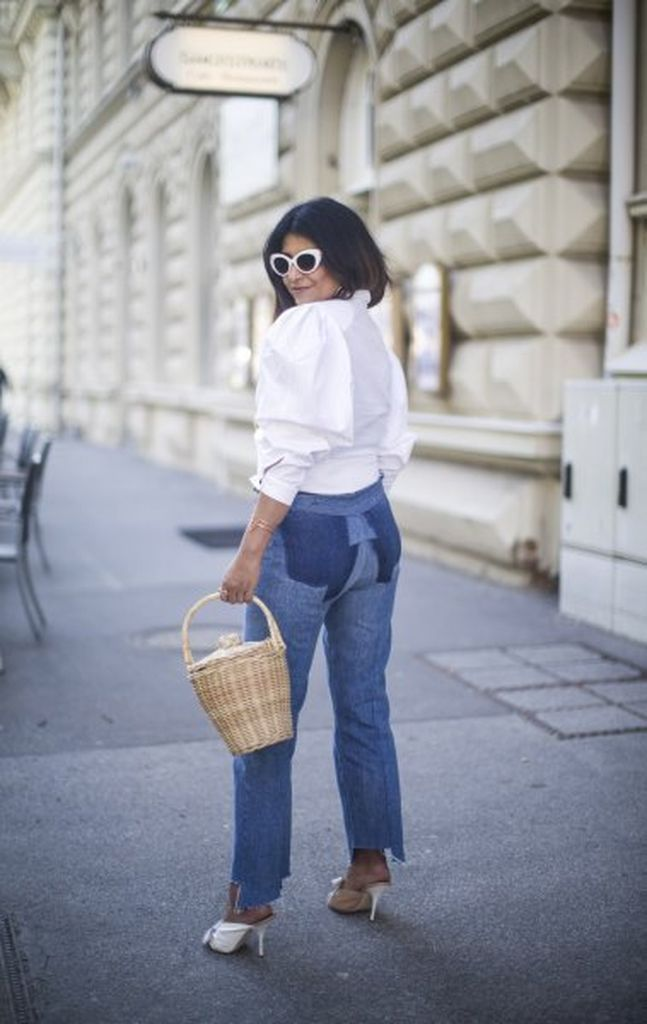 An awesome casual outfit with white puff button up blouse with mom jeans to complete your style