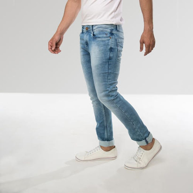 An amazing silver slim fit jeans with white shoes for best style