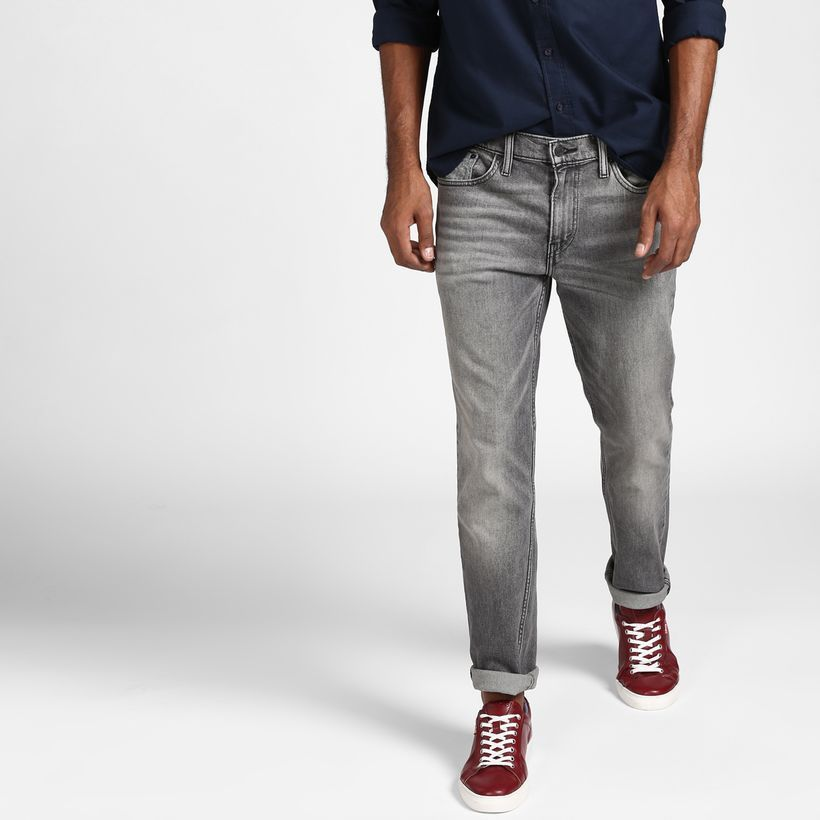 An awesome gray slim fit jeans with red shoes look amazing