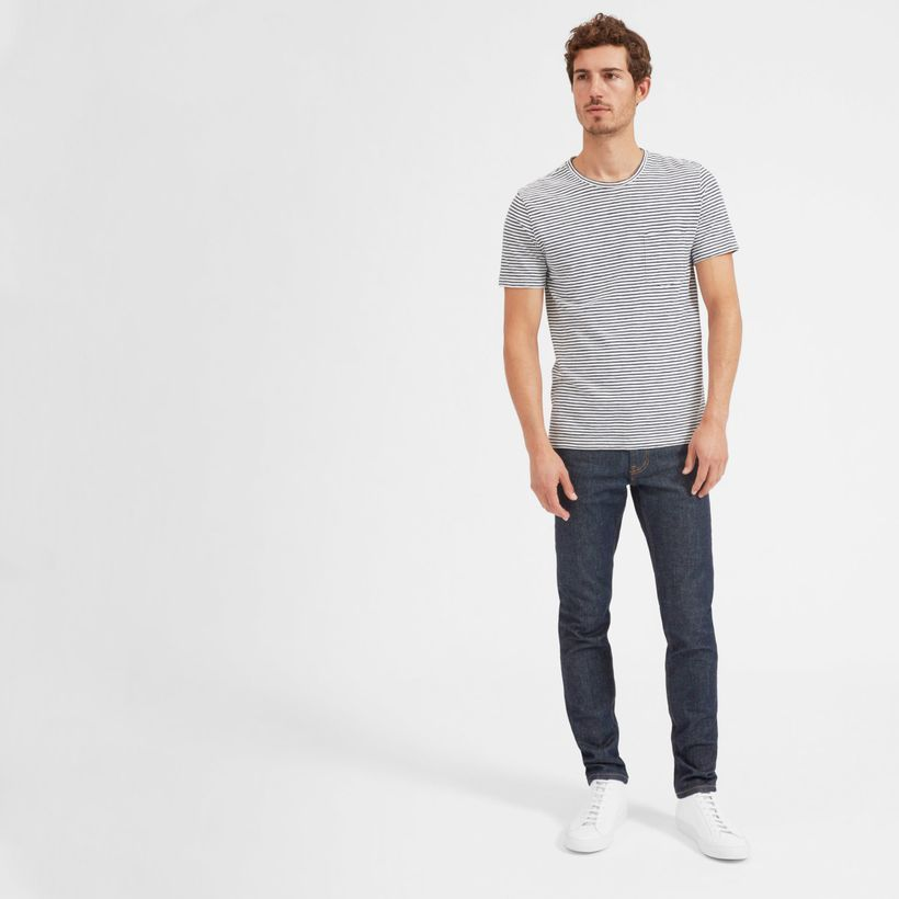 An amazing slim fit jeans with white shoes for good looking
