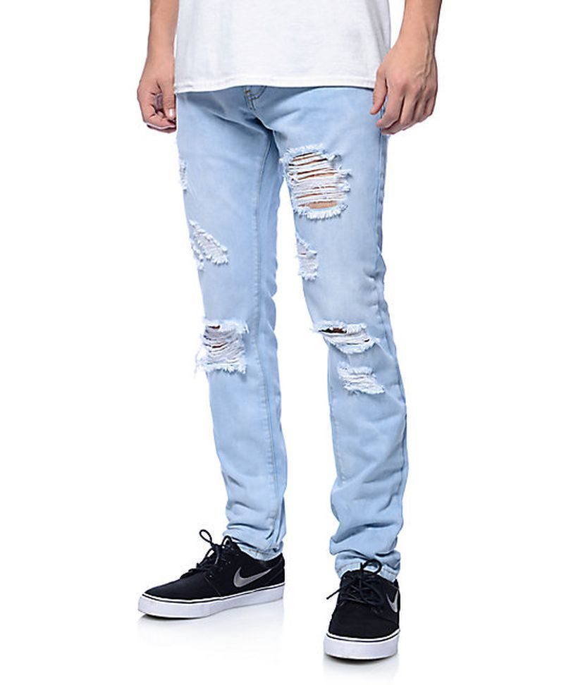 Stunning light blue ripped slim fit jeans with black shoes for handsome man