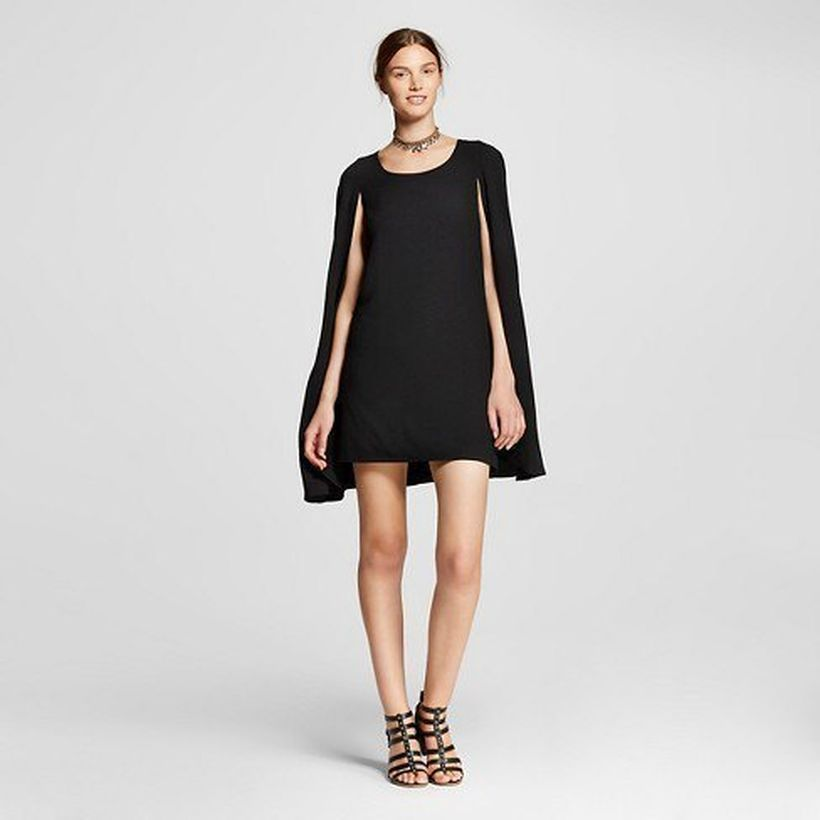 Black cape shift mini dress with black strappy high heels to look pretty