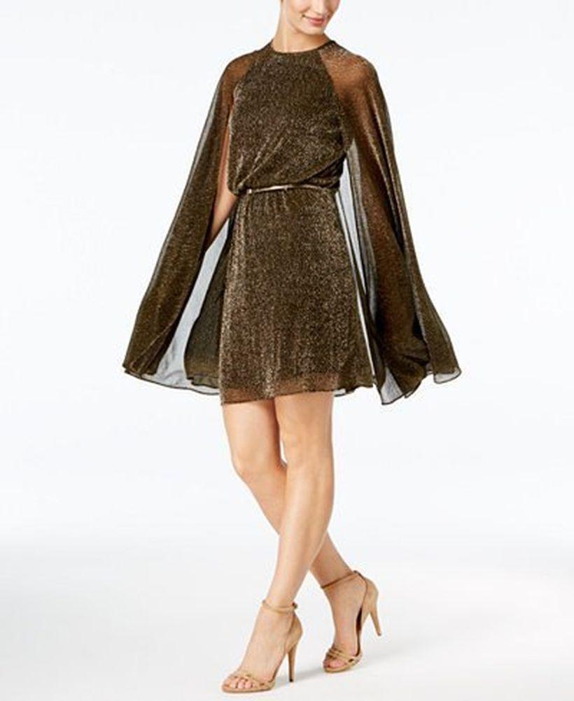 Intresting brown belted semi sheer cape dress with beige high heels to look elegant