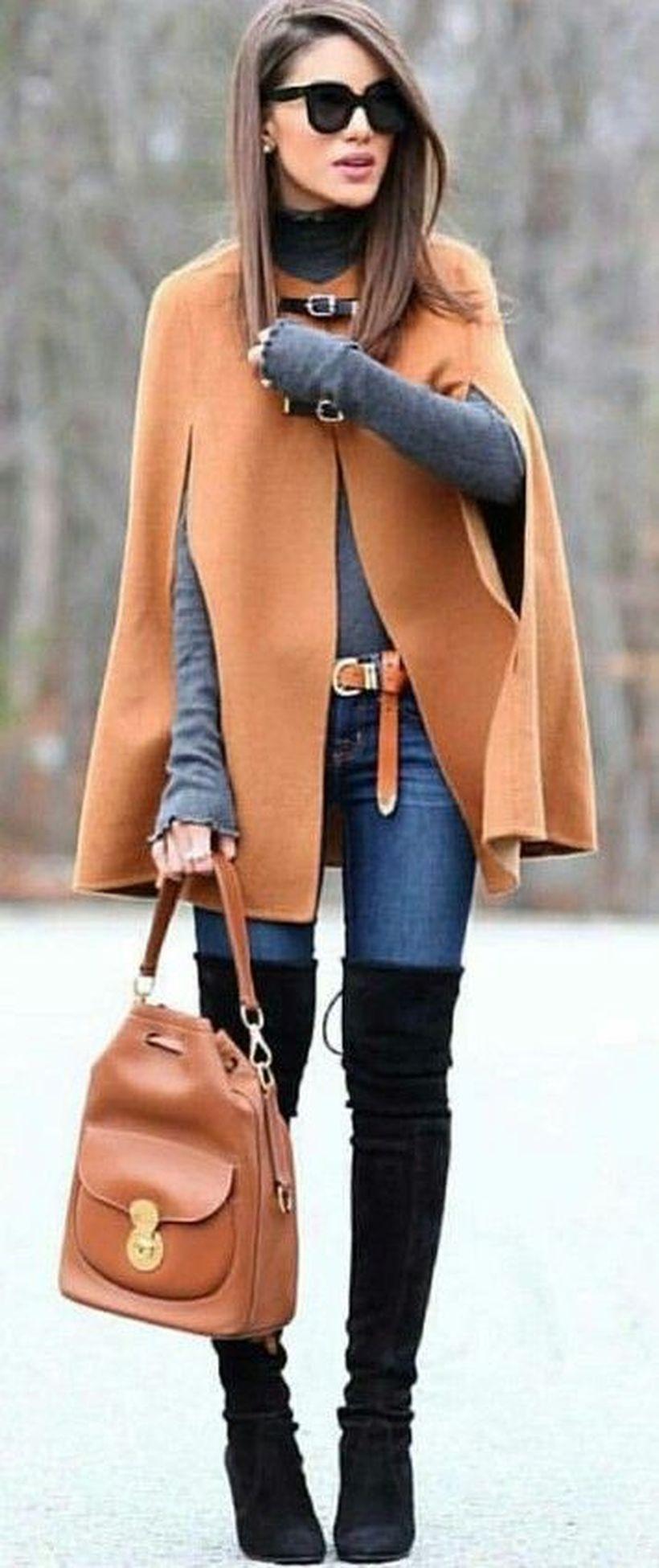 Brown cape blazer with gray jacket combine blue denim pants and long black shoes