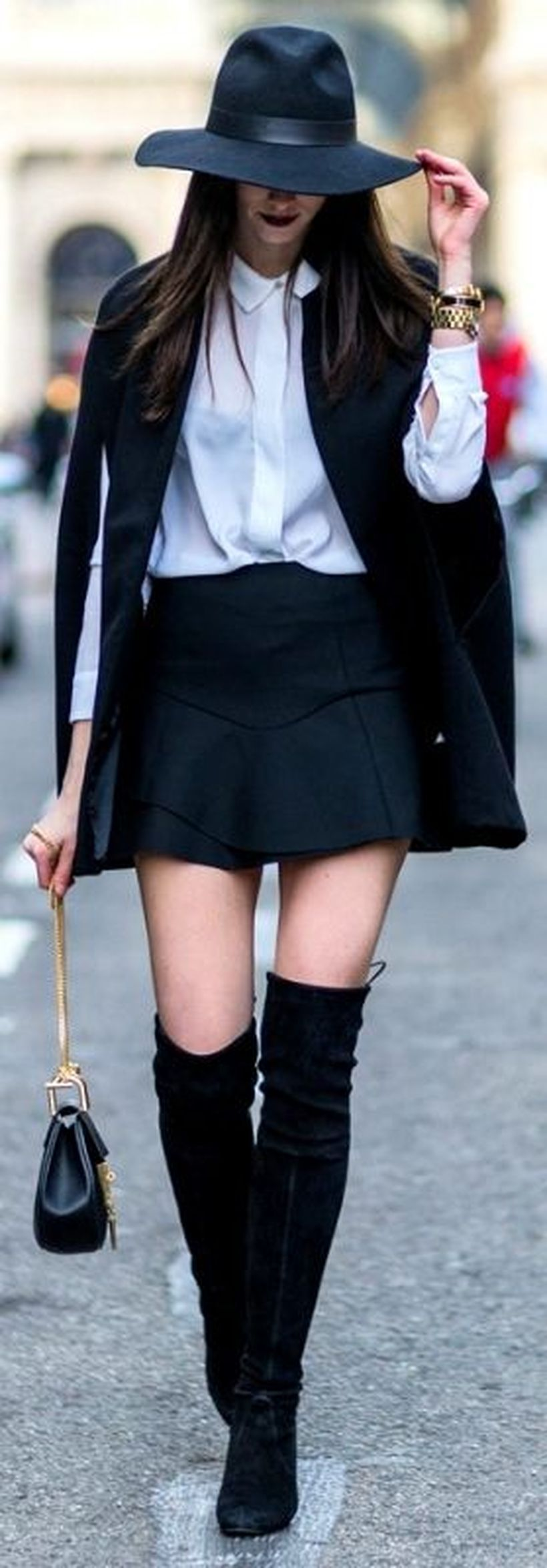 Beautiful outfit with black cape blazer, white shirt, mini black skirt, and long black shoes