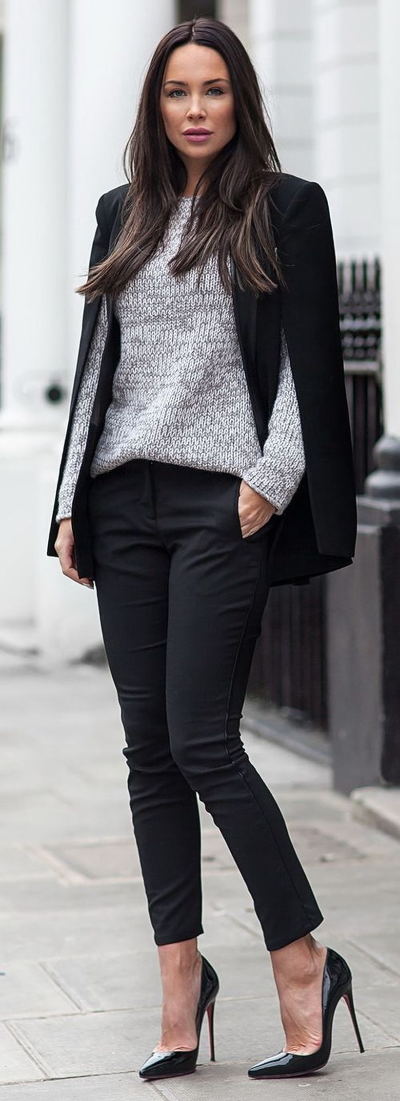 Elegant outfit with black cape blazer, gray jacket, black pants and black high heels