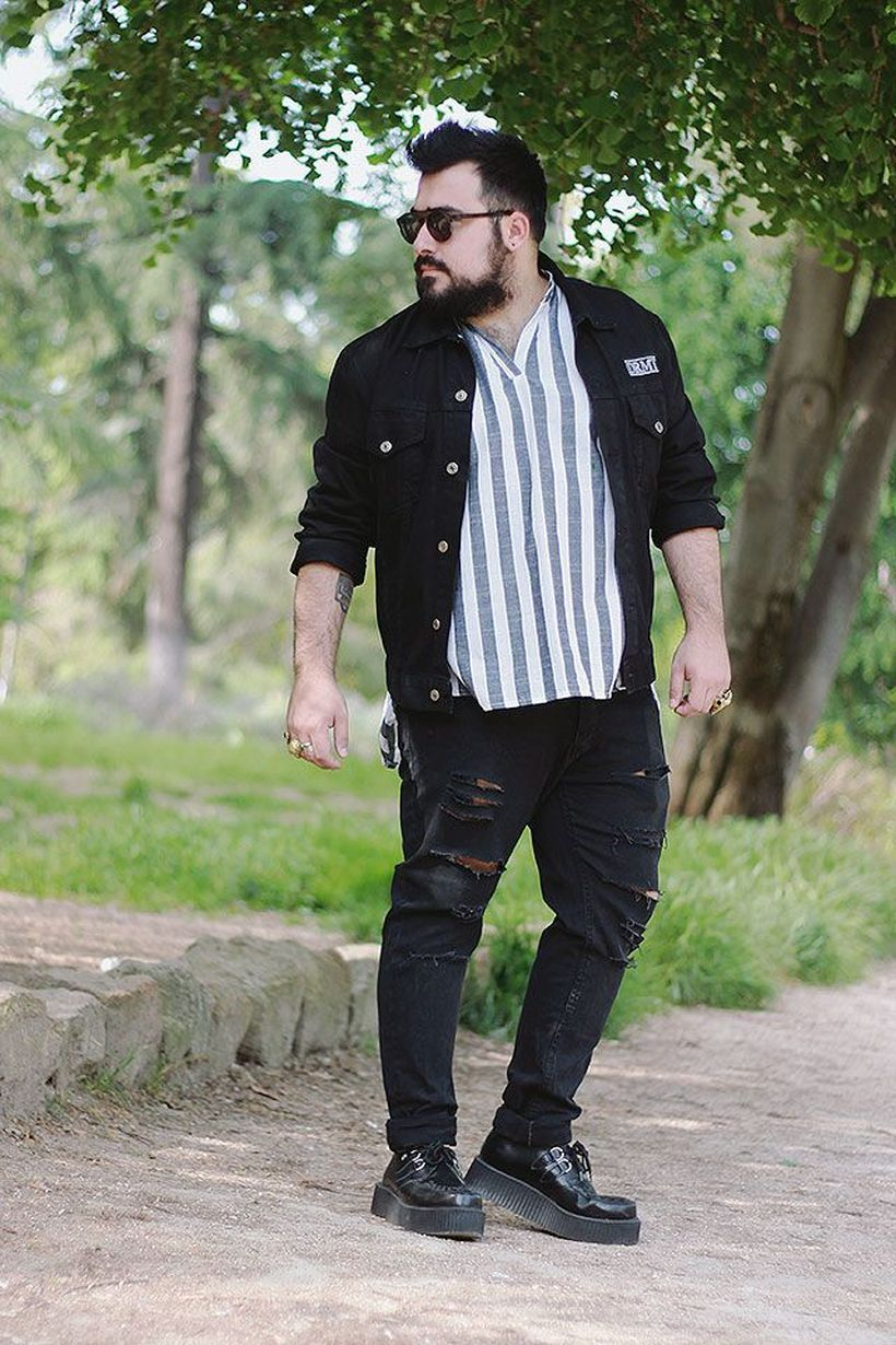Black jacket with striped shirt and black ripped jeans