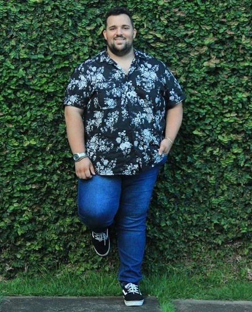 Flowers shirt with blue jeans and black shoes