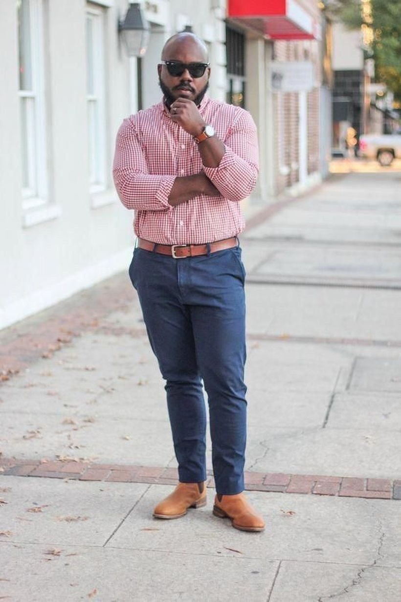 Pink shirt with blue denim pants and brown shoes