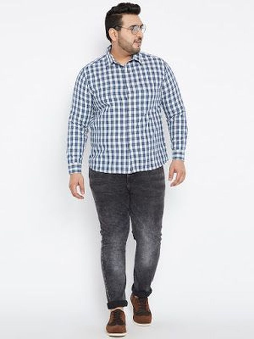 Long sleeve plaid shirt with denim pants and brown shoes