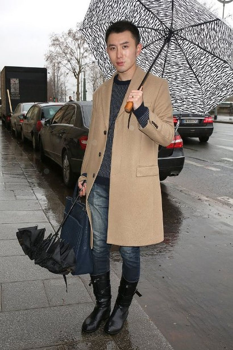 Cute-outerwear-for-men-with-brown-coat-striped-sweater-black-boots-and-add-umbrella-for-additional-luggage-in-the-fall-season