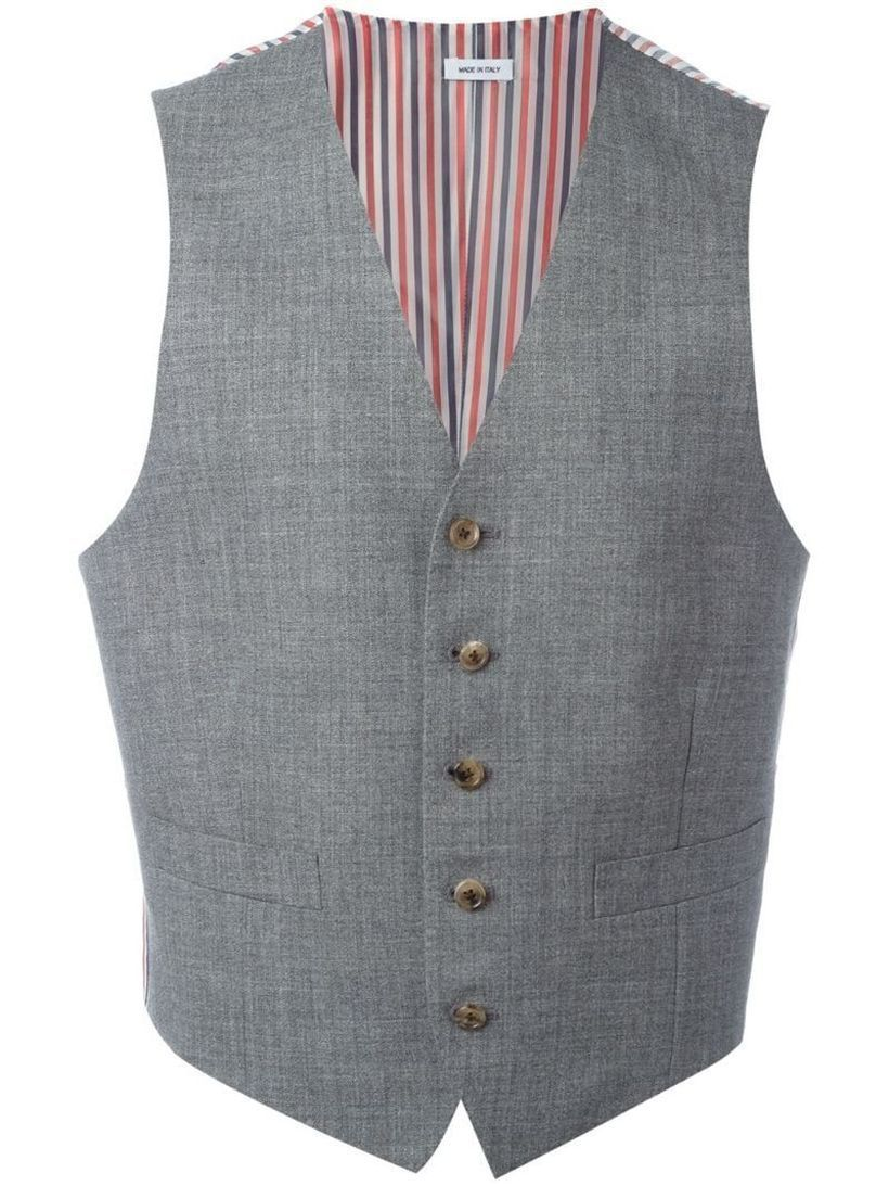 Grey-vest-with-a-striped-layer