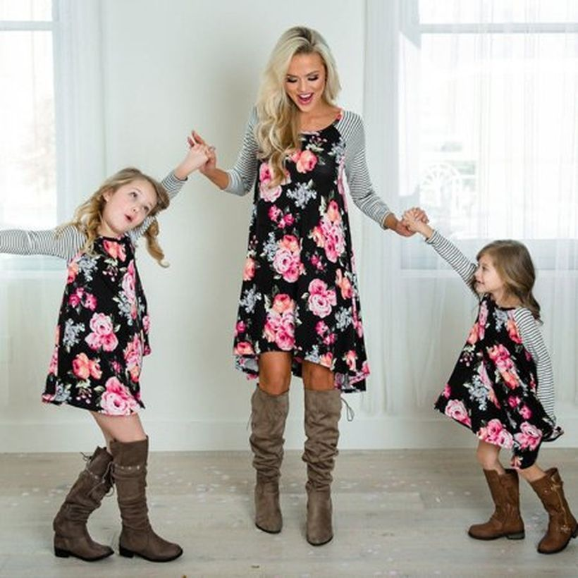 Fall-matching-outfit-for-mom-and-daughter-with-flower-dress-striped-arm-and-brown-boots-to-look-chic