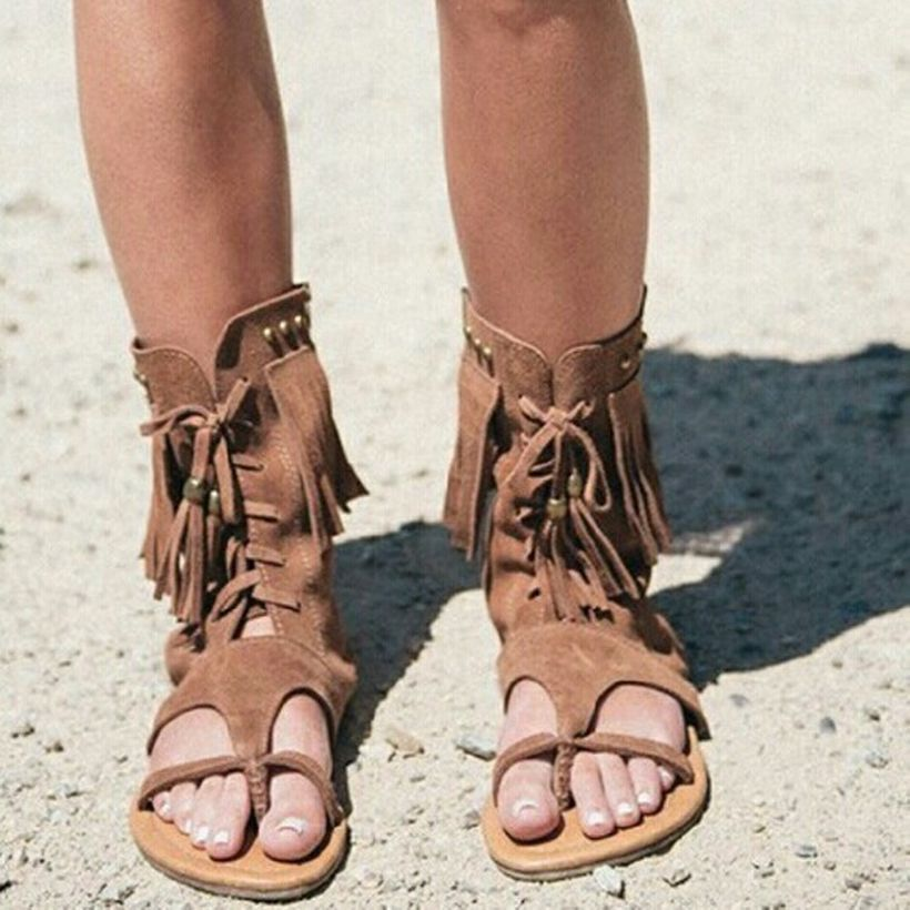 An adorable footwear with brown fabric for take a walk on the beach