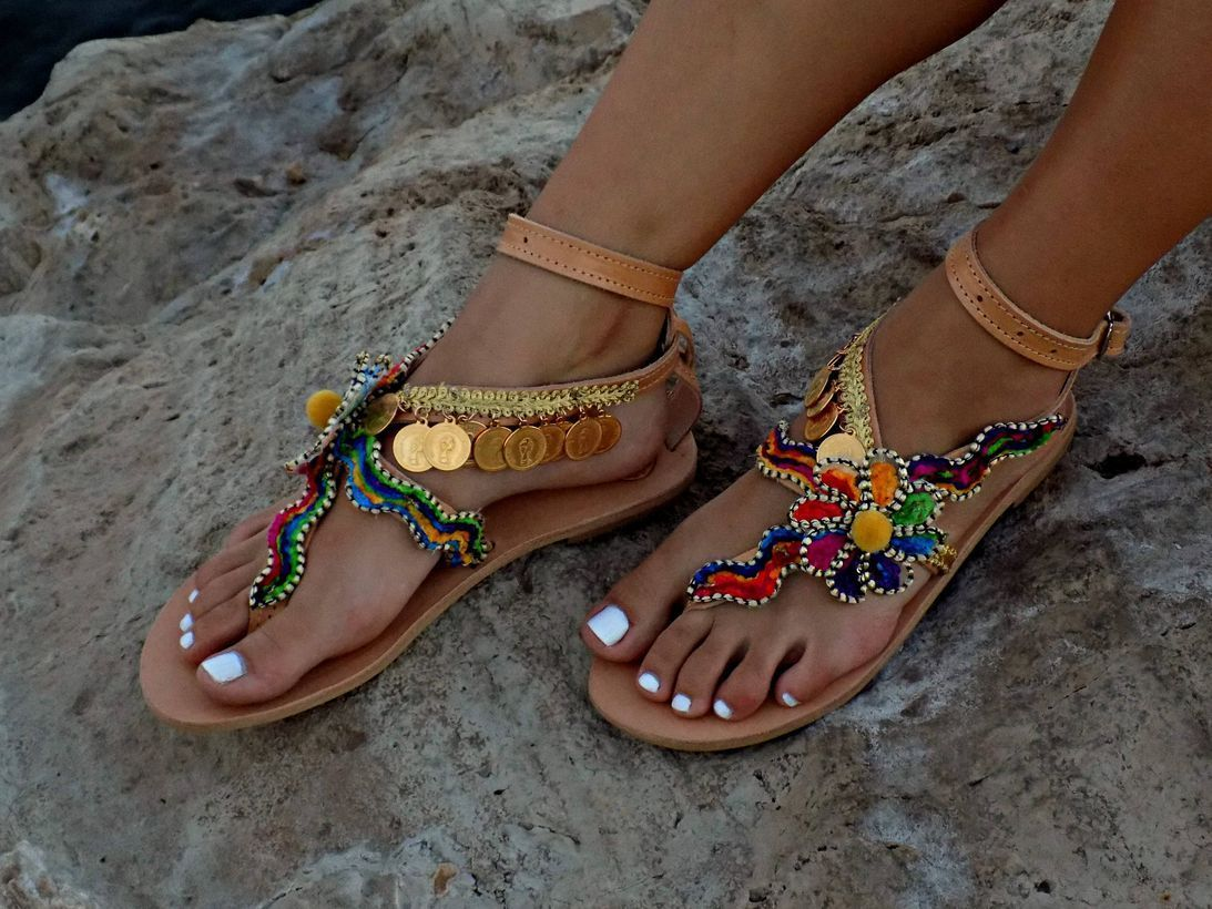 Colorful footwear with flowers ornament, small gold coins to look elegant