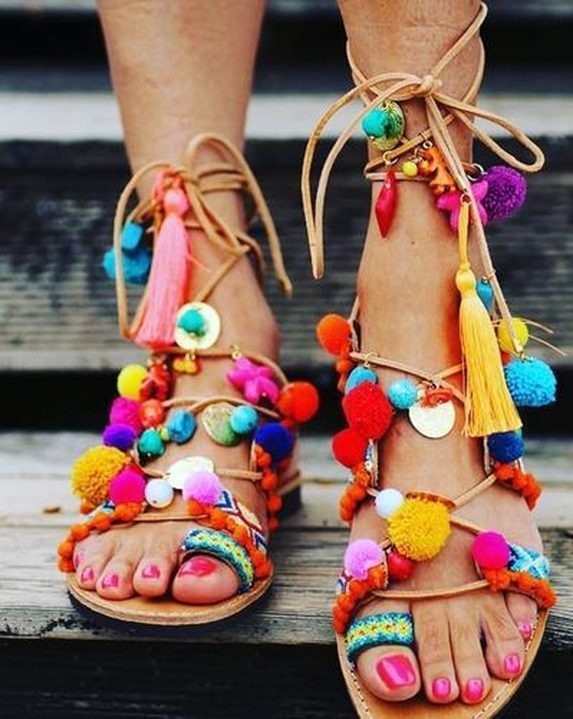 Wonderful footwear with colorful pom-pom to look cute