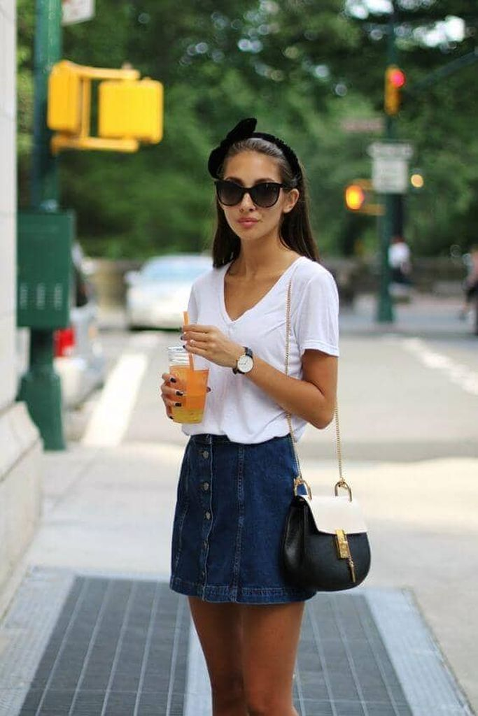Beautiful casual outfit with white t-shirt and denim skirt combined with sling bag to perfect your style