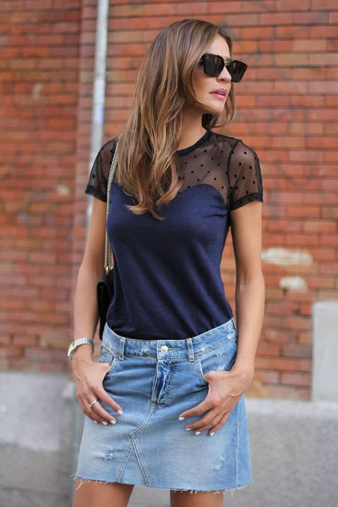 An awesome outfit style for women with eye-catching t-shirt combined a light denim skirt to beautify your style