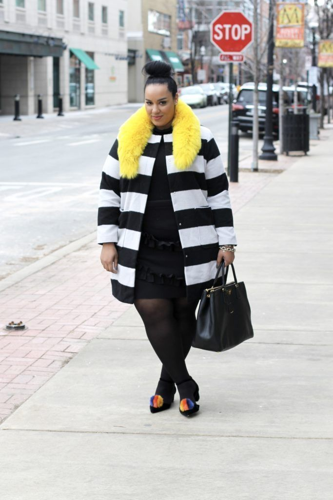 Black dress combined with striped coats