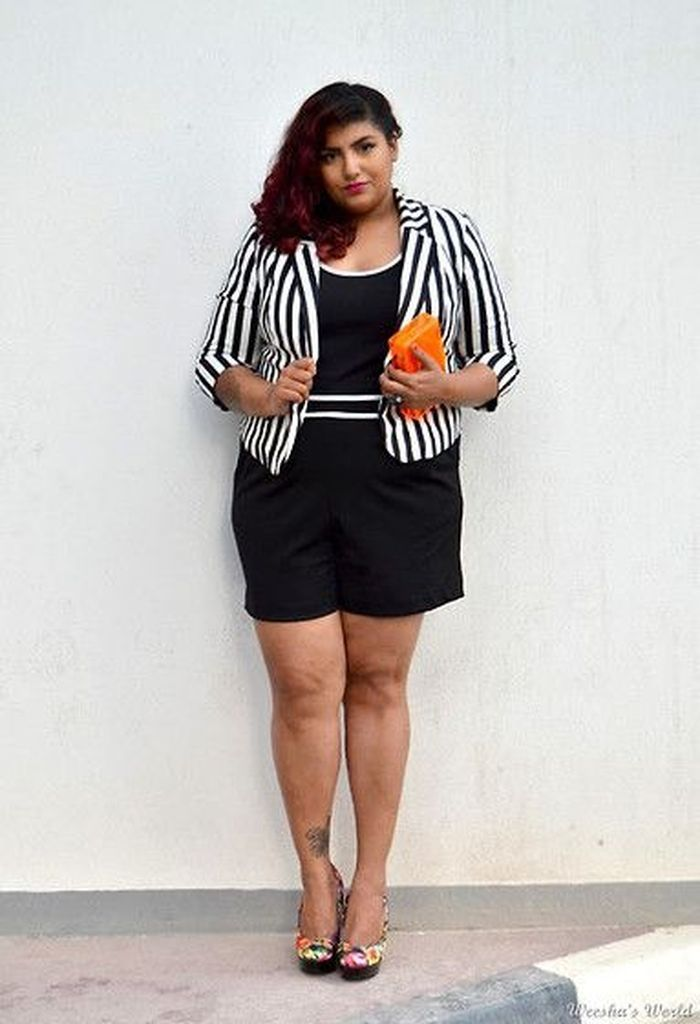 Striped blazer combined with all-black outfit
