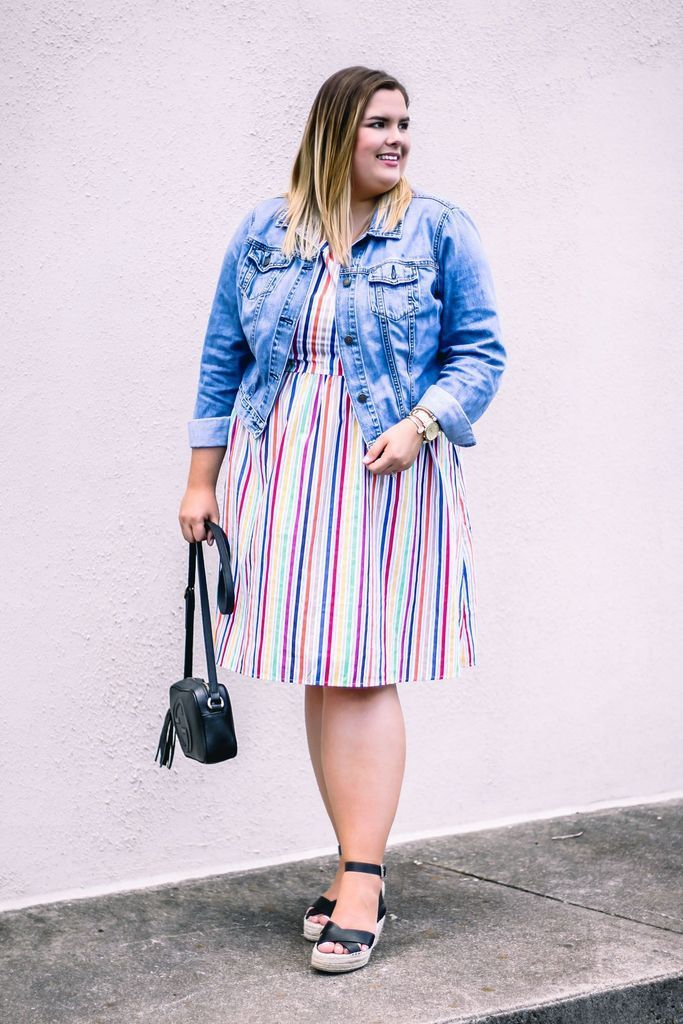 Denim jacket combined with striped dress