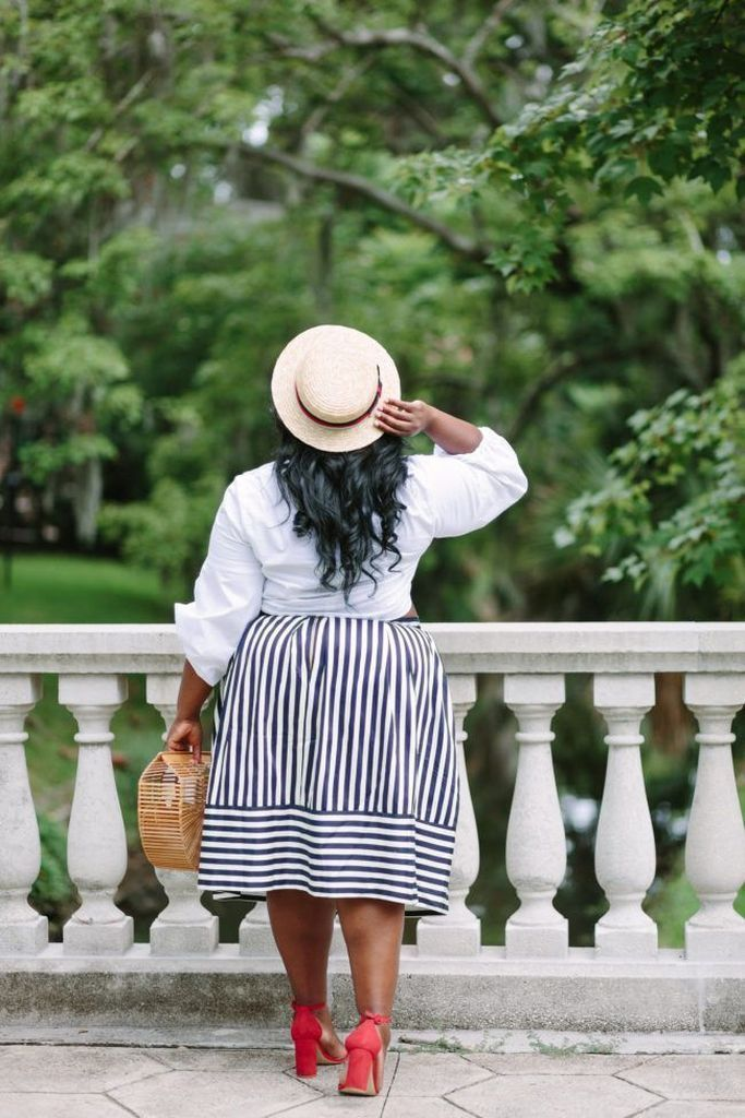 White shirt combined with striped skirt