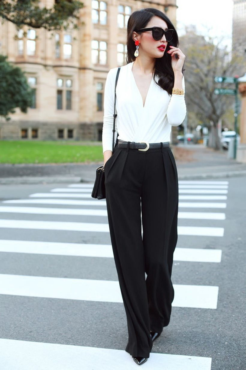 V-neck-white-blouse-looks-sexy-tucked-in-relaxed-fit-black-trousers.-