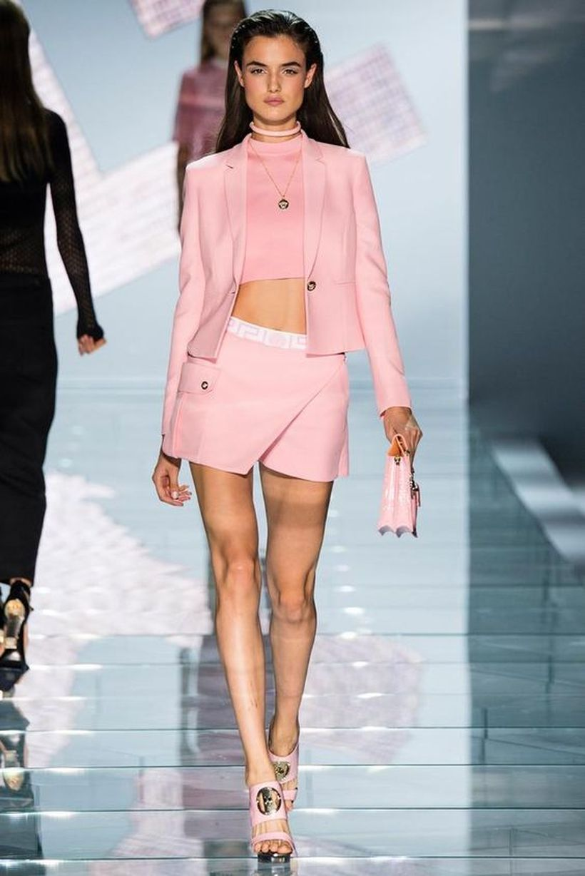 An-adorable-pink-monochrome-outfit-with-pink-sweater-pink-top-pink-short-skirt-folded-pink-handbag-and-pink-high-heels.-