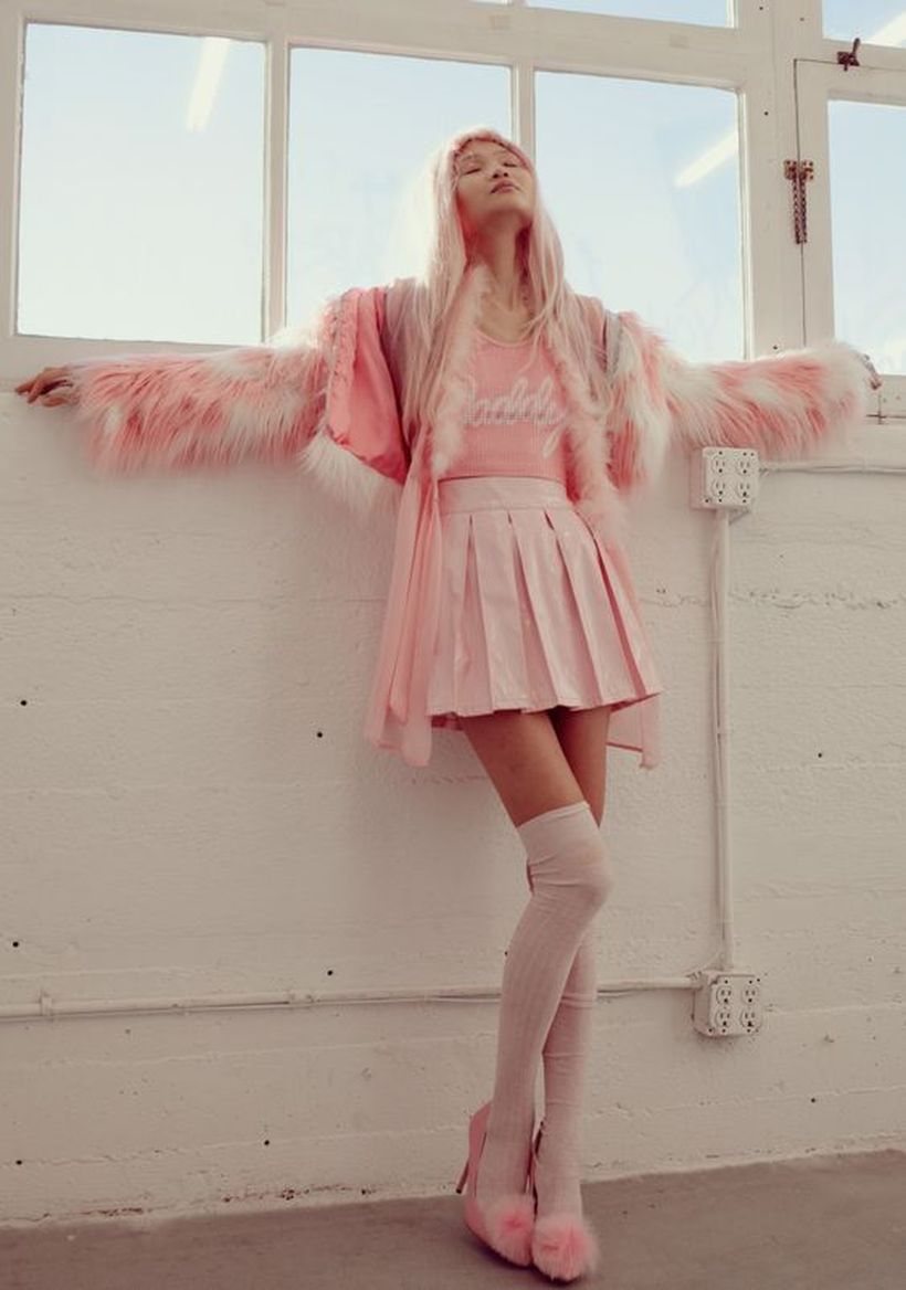 An-incredible-pink-monochrome-outfit-with-pink-furry-jacket-pink-top-short-skirt-folded-and-pink-high-heels-to-impress-everyone.-