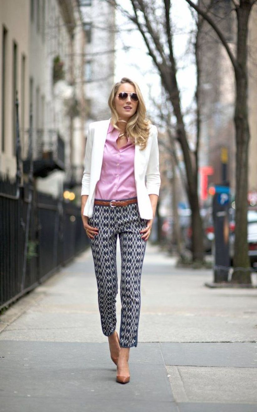 A-comfortable-pink-mix-and-match-outfit-with-a-pink-shirt-clad-in-a-white-blazer-with-patterned-trousers-underneath-is-still-enchanting.-