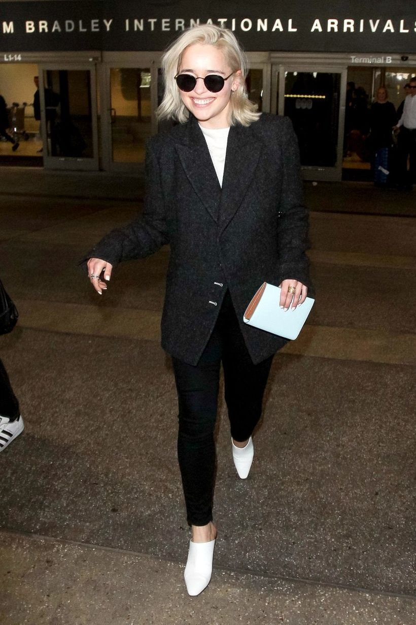 Simple-black-suit-white-t-shirt-and-white-slippers-shoes-for-a-balance-between-comfy-and-cool