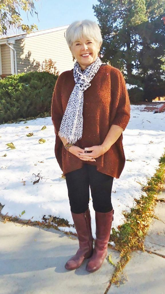 Brown cardigan combined with black and white scarf