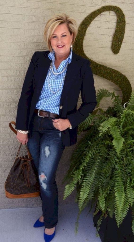 Black blazer combined with plaid shirt
