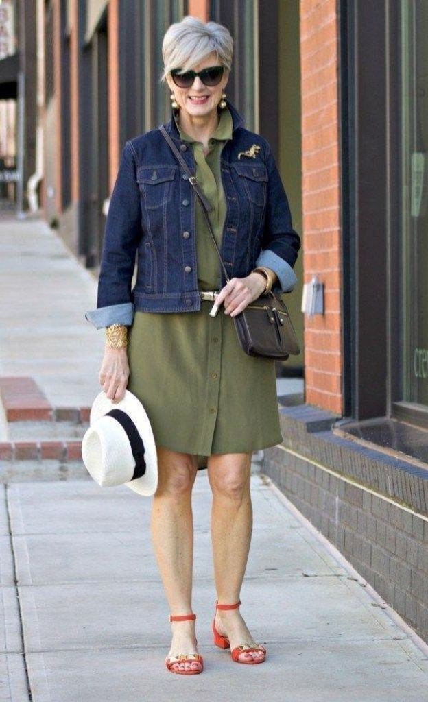 Green dress combined with denim jacket