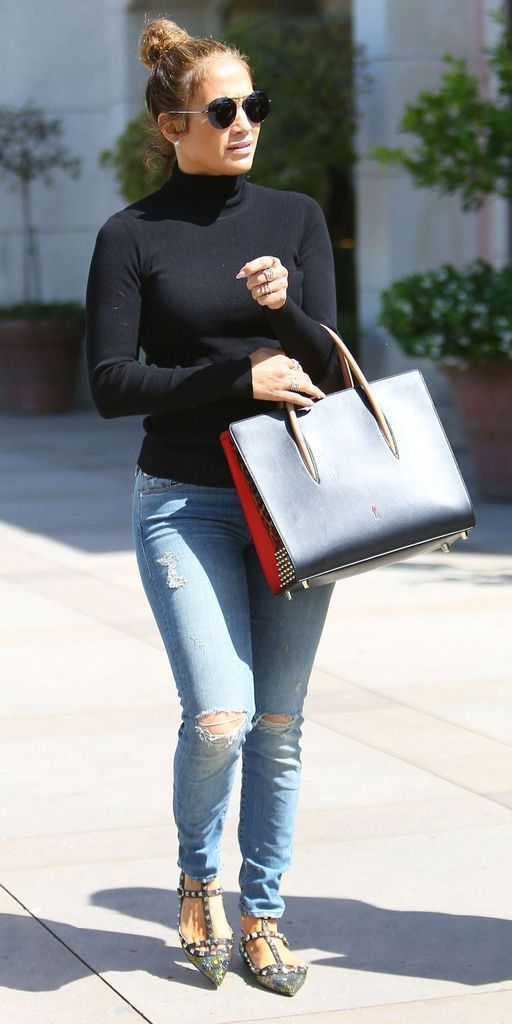 Black top combined with hand bag and jeans