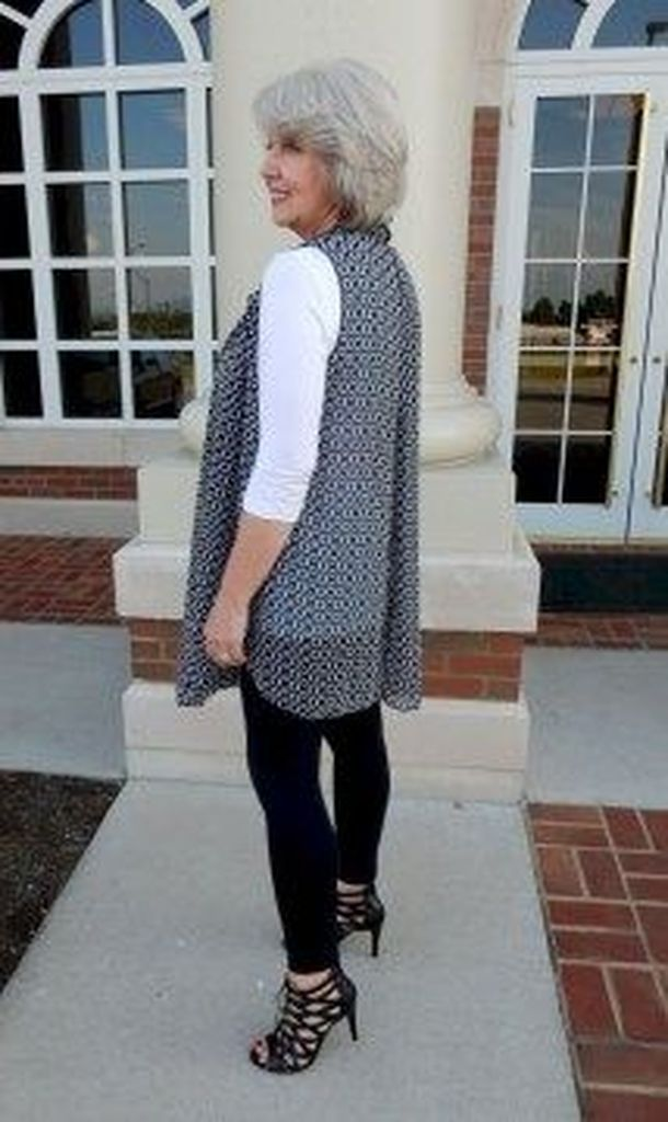 Patterned vest combined with black legging and high heels