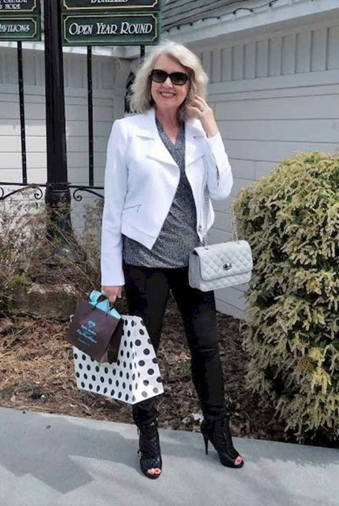 White blazer combined with black pants