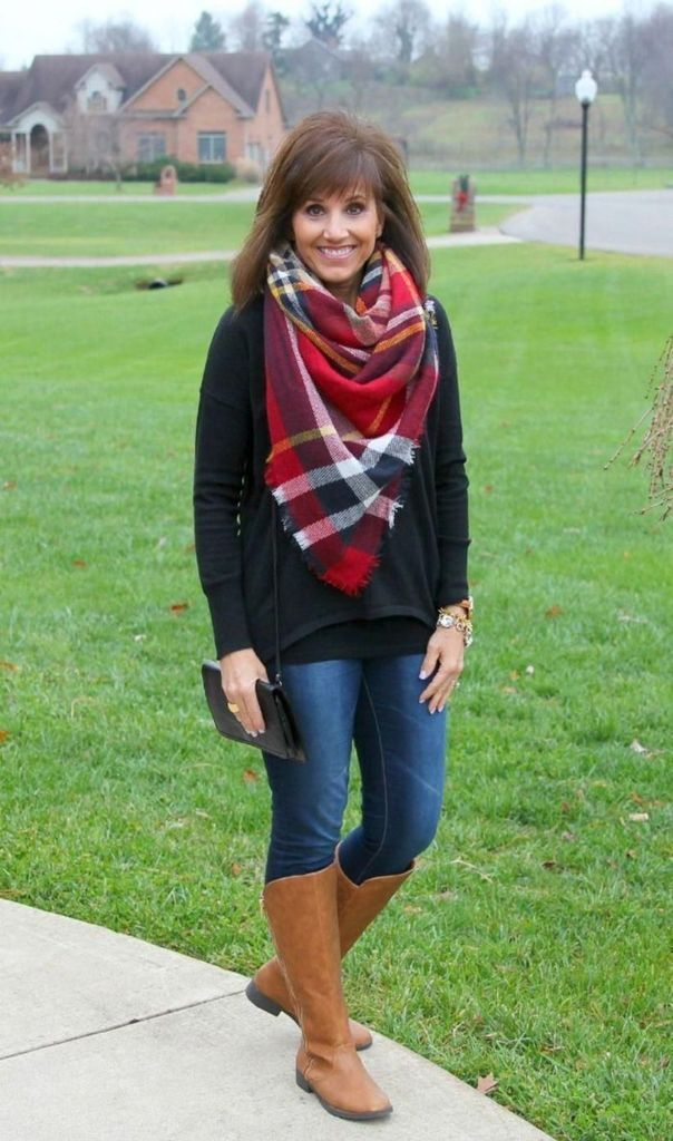 Striped scarf combined with jeans and brown boots